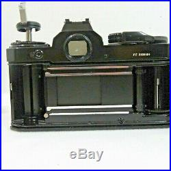 Nikon Fe 35 MM Slr Film Camera With 28 MM 13.5 Nikkor Lens And Extras