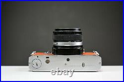 Olympus OM10 35mm Film Camera with 50mm f/1.8 Zuiko Lens Orange Leather Serviced