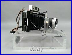 Polaroid Land Camera Model 180 with Tominon 114mm f4.5 Lens and Accessories