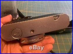 Vintage Nikomat FT SLR Camera with2 Nikkor Lenses 12 35mm, Auto 12.8 135mm Works
